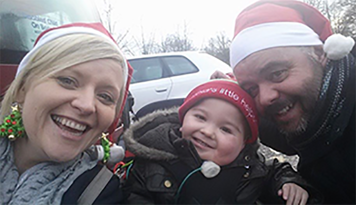 Laura, Tom and Colin wearing Santa hats