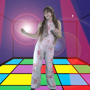 Melody dancing on a multicoloured disco floor