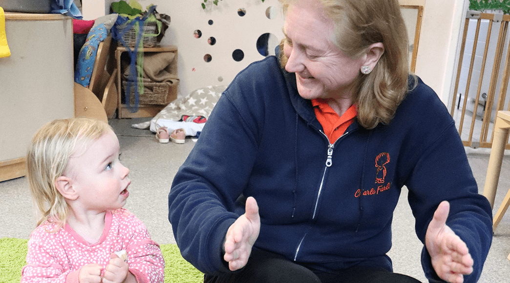 Makaton Tutor Fiona Cockram signing with a young girl