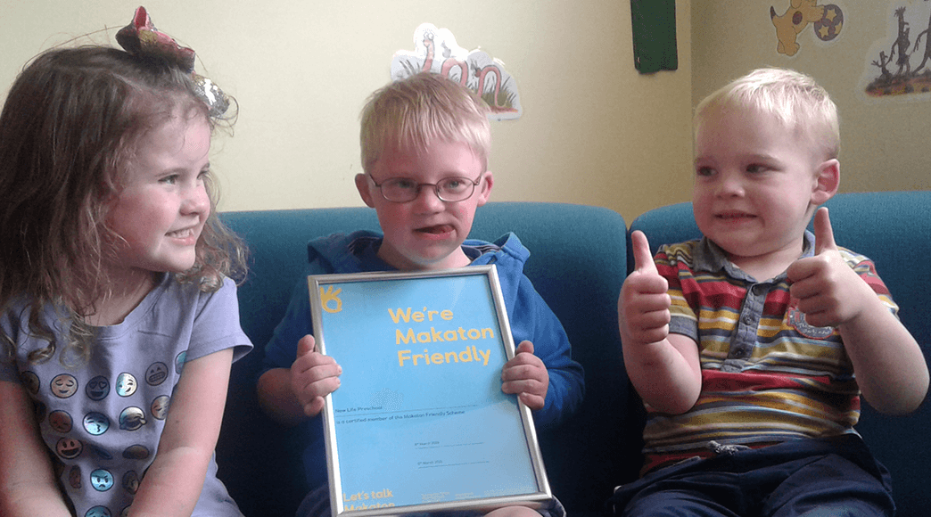 Children holding Makaton Friendly certificate