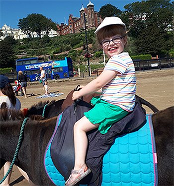 Gracie riding a horse
