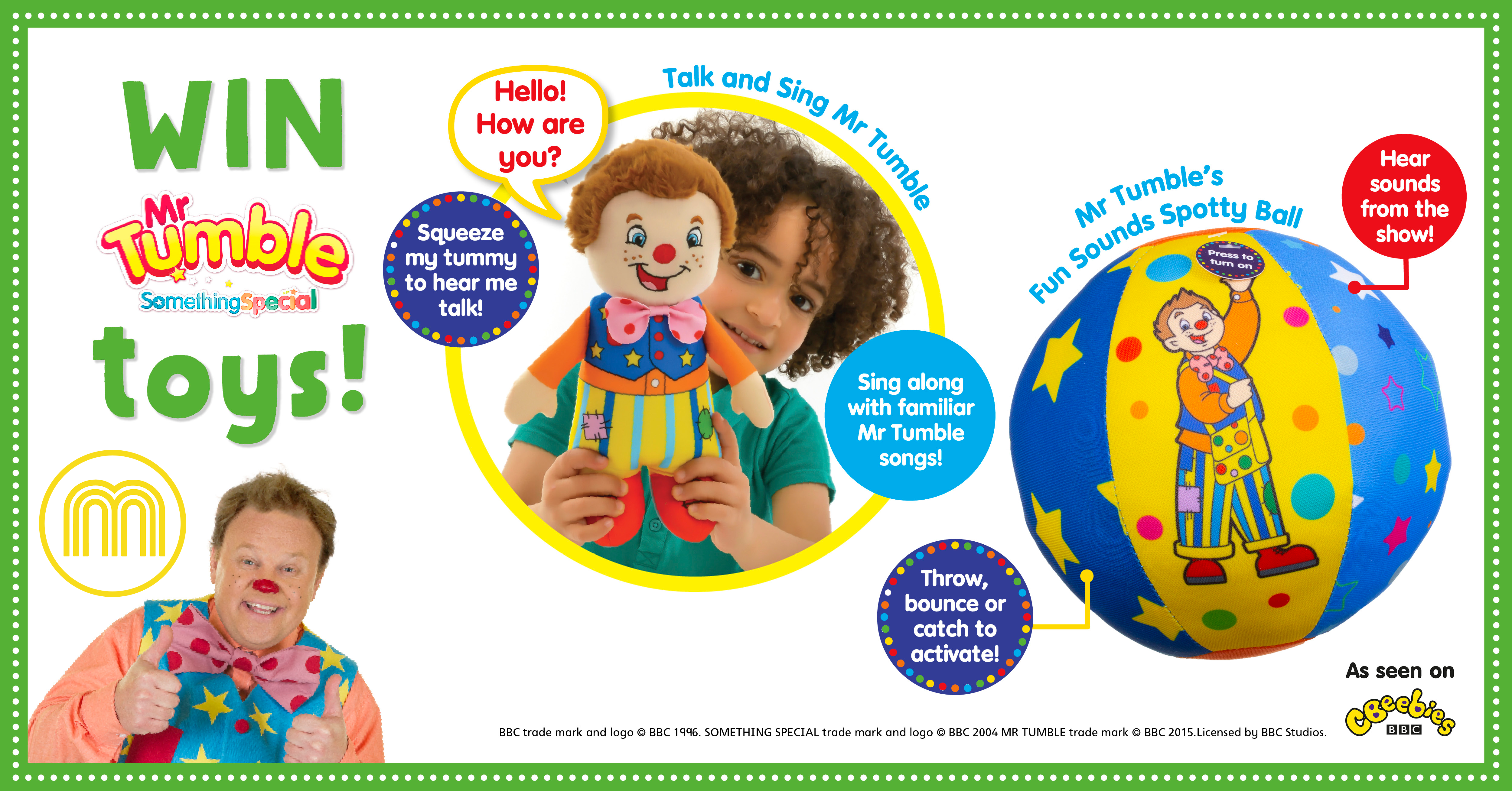 A young child holding a Mr Tumble doll, and a ball with a picture of Mr Tumble on it
