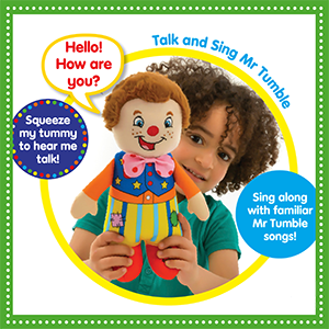 A young child holding a Mr Tumble doll